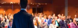 Public speaker in front of audience